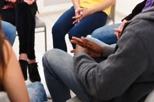 Clients sit in a circle at their cocaine addiction rehab center