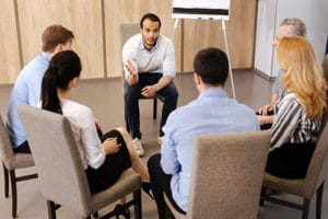 Counselor leading a group therapy program