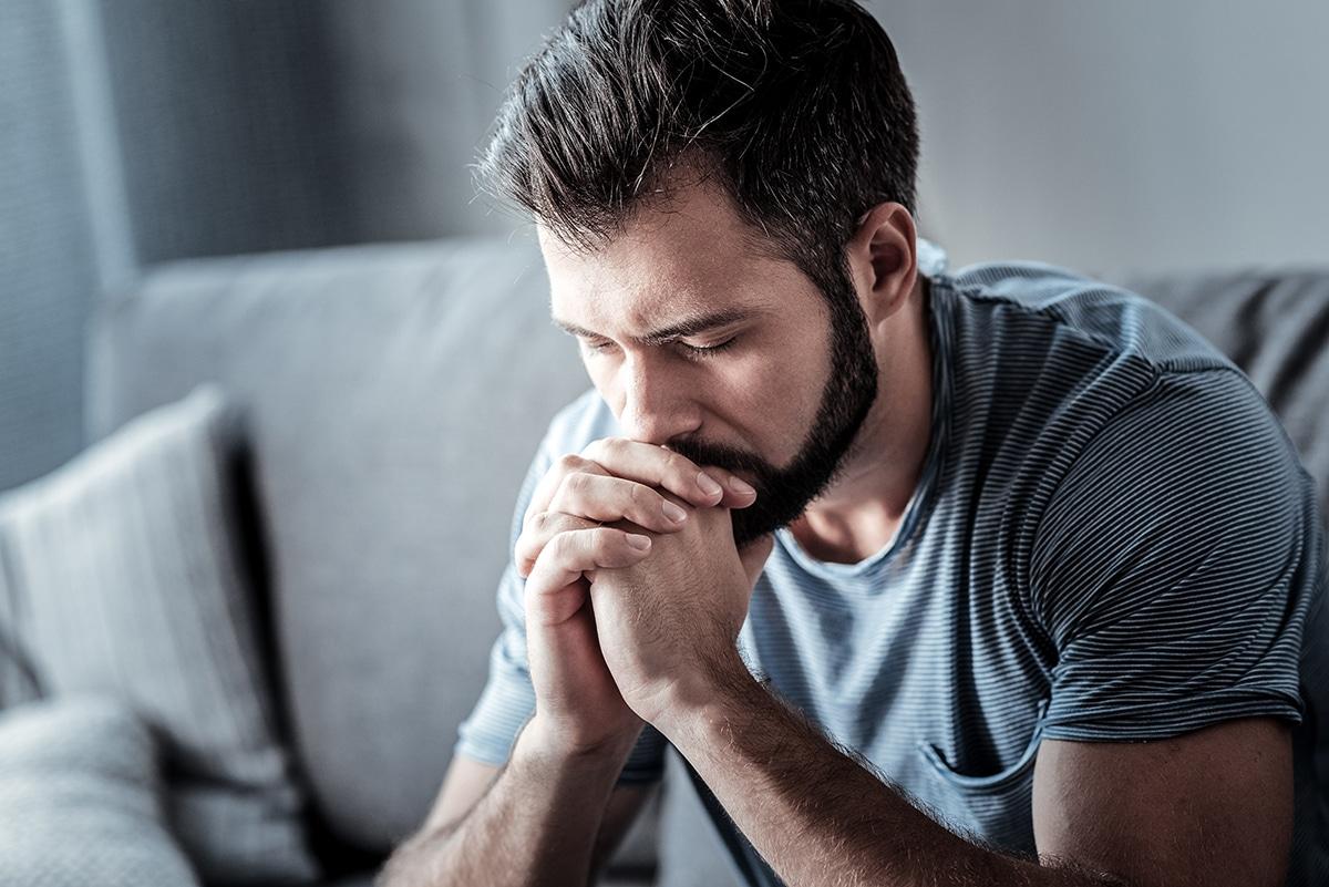 Man going through heroin withdrawal symptoms