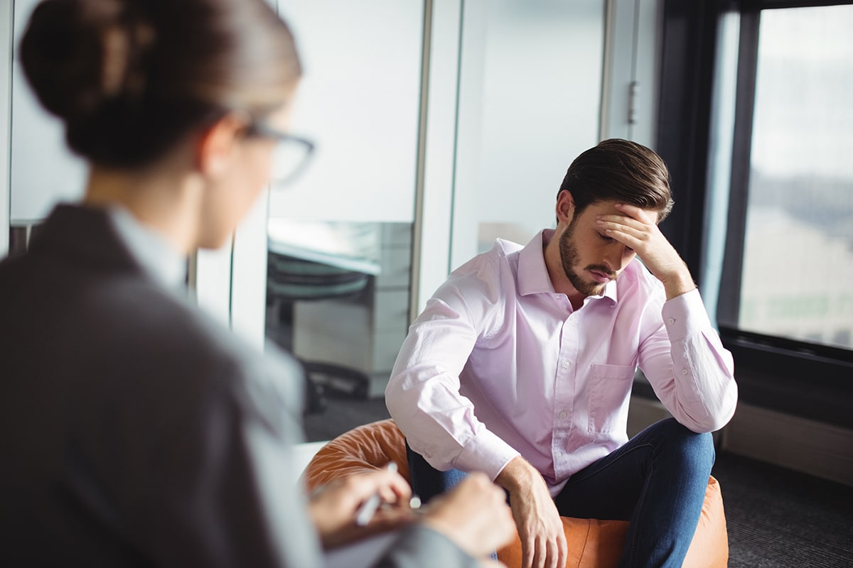 Man speaks to his therapist about breaking the cycle of addiction