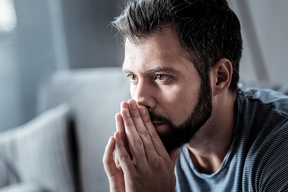 a man struggling with trauma and addiction