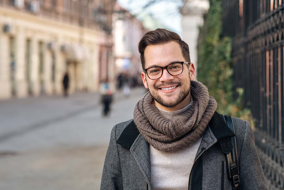 man in peacoat and scarf smiling about the heroin addiction recovery rate