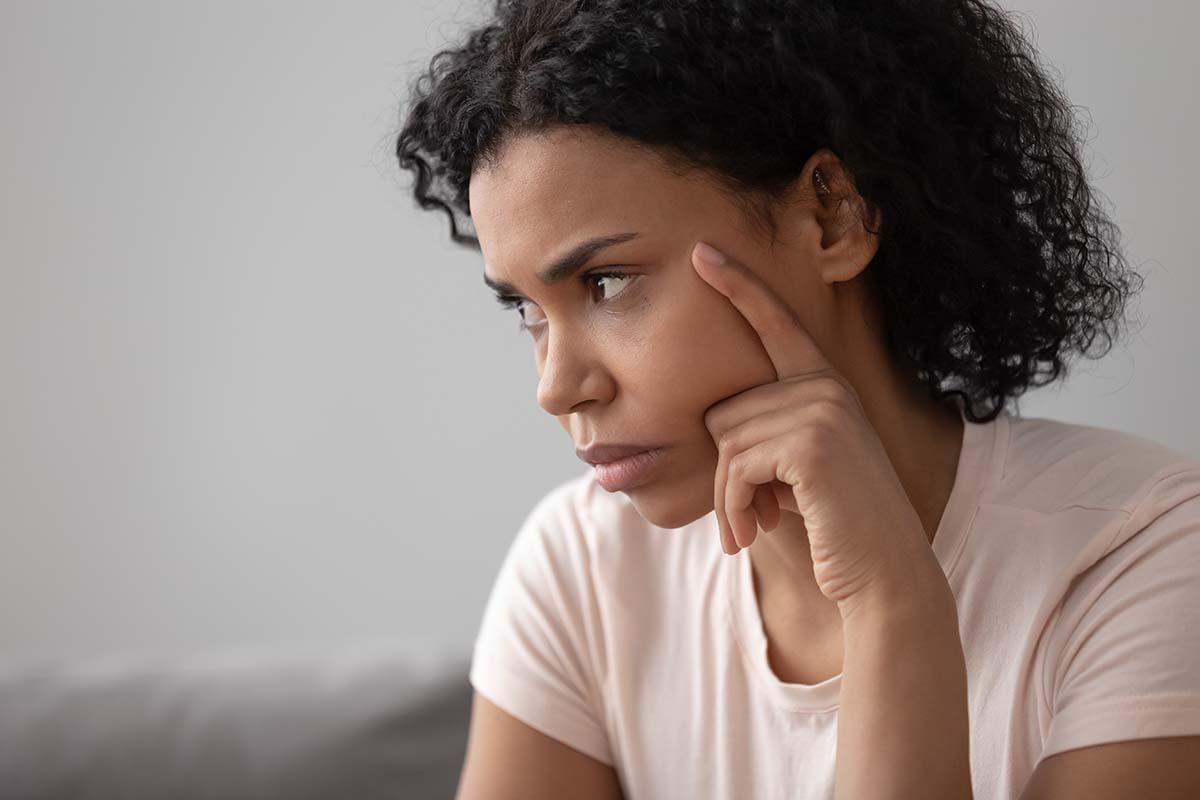 pensive woman wondering about symptoms of vicodin abuse