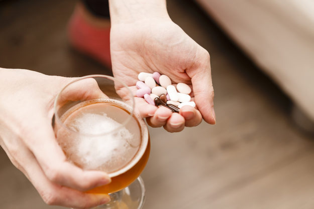 A woman holds xanax and alcohol and wonders about the effects