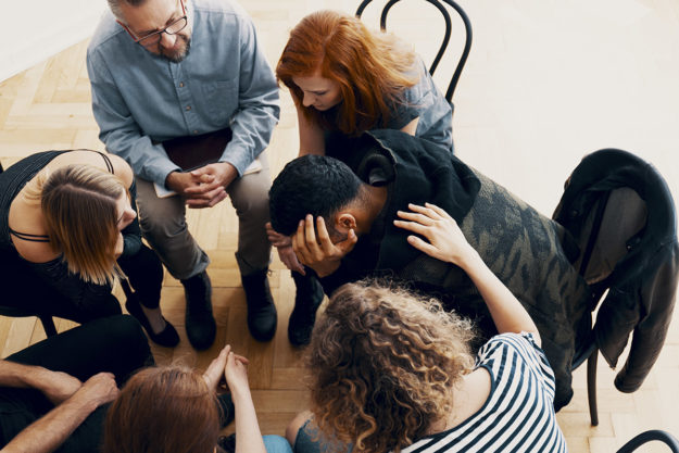 therapy circle discusses how to help an addict
