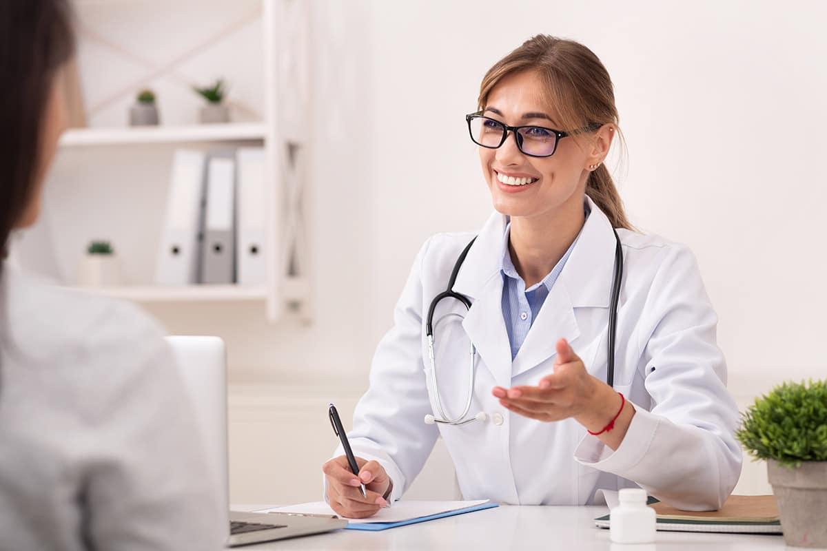 doctor explains partial hospitalization for addiction treatment to patient
