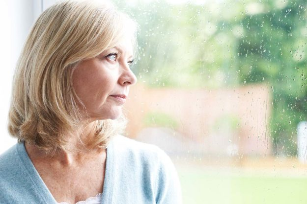 woman wondering about biological effects of alcoholism