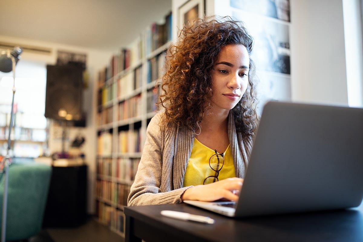 woman on laptop choosing successful addiction treatment