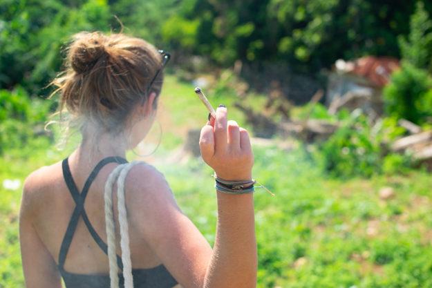 woman with pot cigarette needing marijuana addiction rehab center