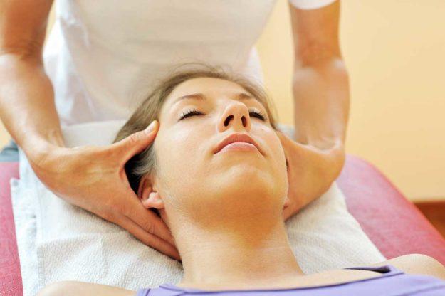 patient getting holistic treatment massage