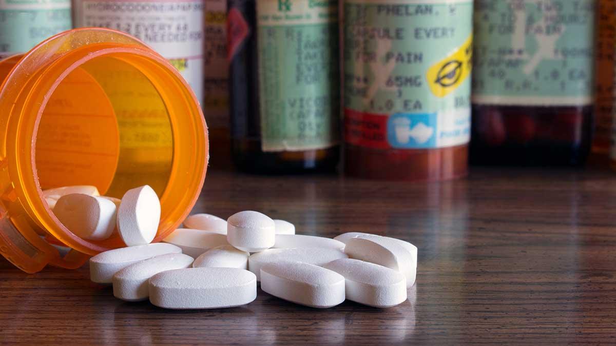 spilled pill bottle of prescription drugs