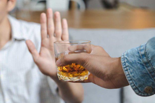 man refuses alcohol