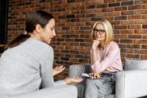 a woman talks through issues in a women's addiction treatment center